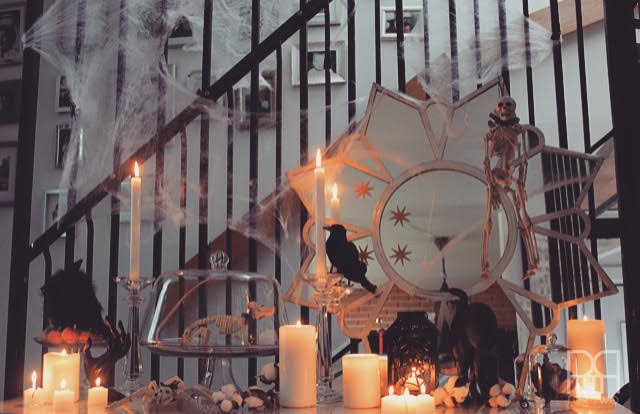 halloween entryway decor with candles lit