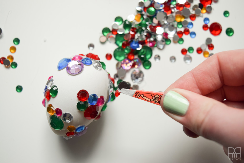 glam egg shown with hand holding tweezers