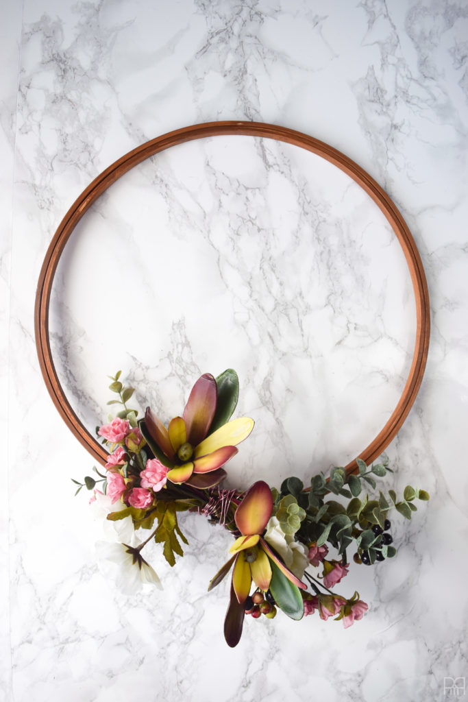 Modern & Moody fall wreath against marble background