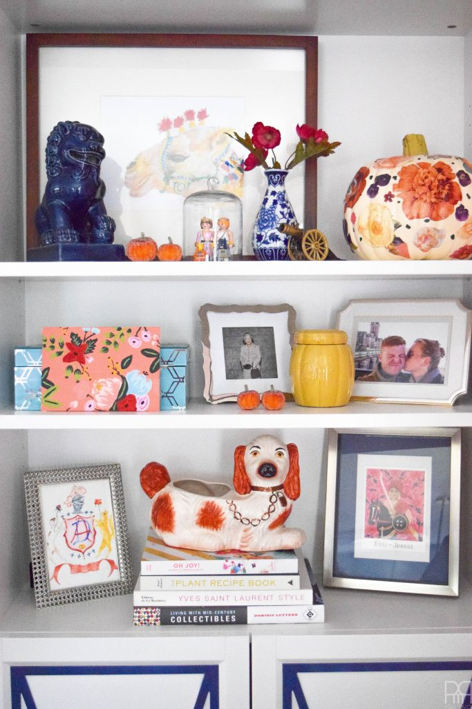 decorated shelves with pumpkins