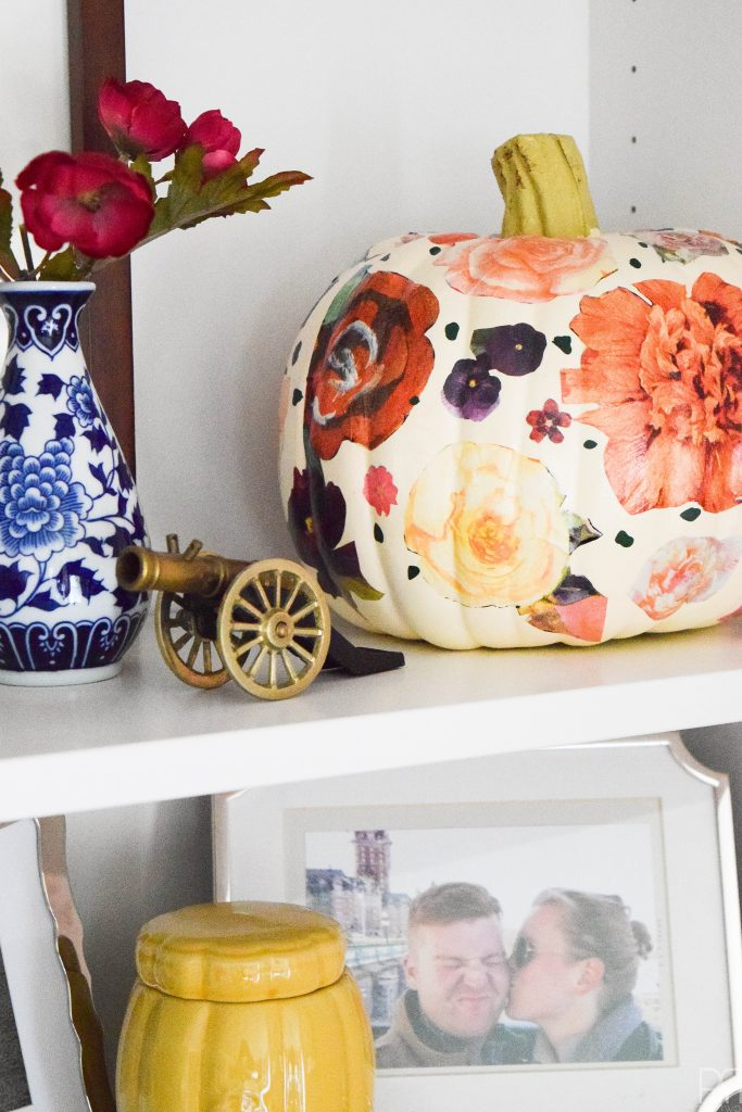 styled shelf with decoupage pumpkin