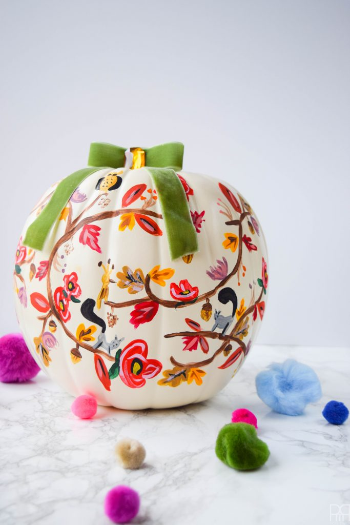 rifle paper co painted pumpkin with pom poms