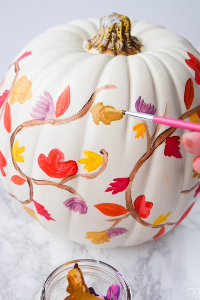 painted white pumpkin with fall leaves