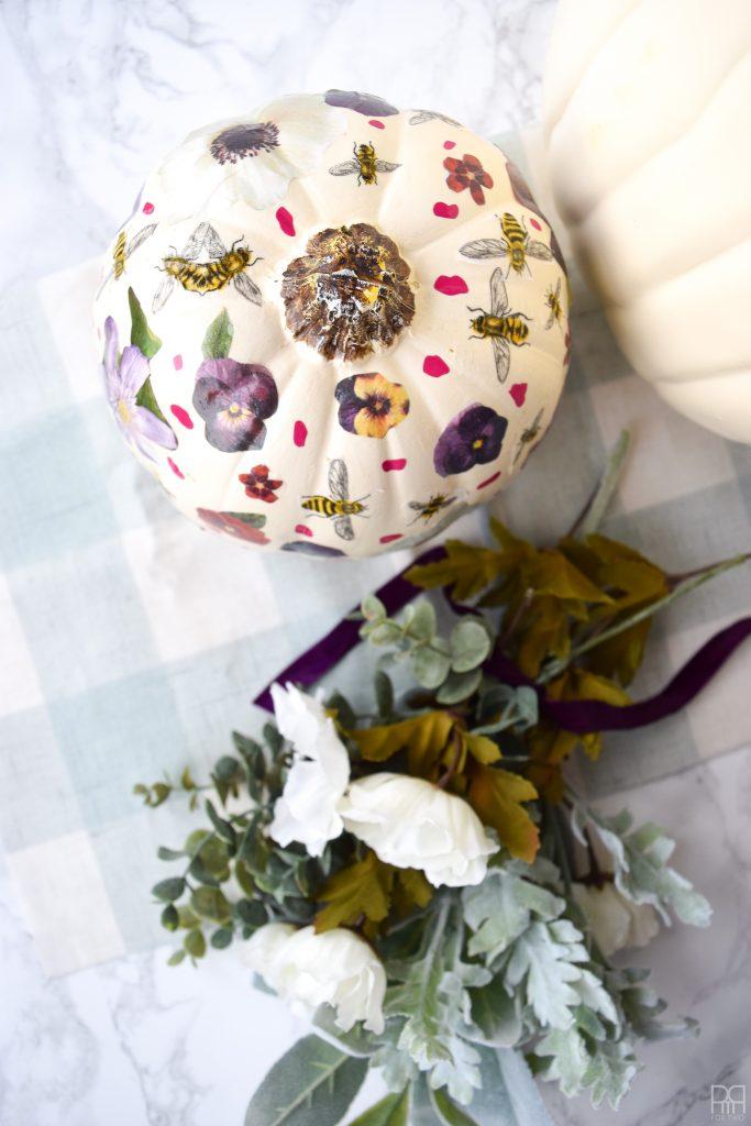 Decoupage Pumpkin next to flowers