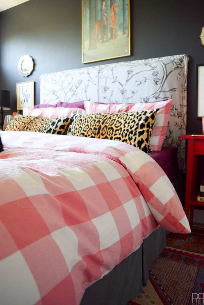 A Black & Bold master bedroom that shines in a rental house. Bold accents and saturated hues complete the room
