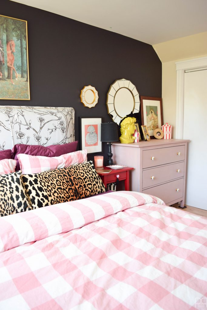 A Black & Bold master bedroom that shines in a rental house. Bold accents and saturated hues complete this space