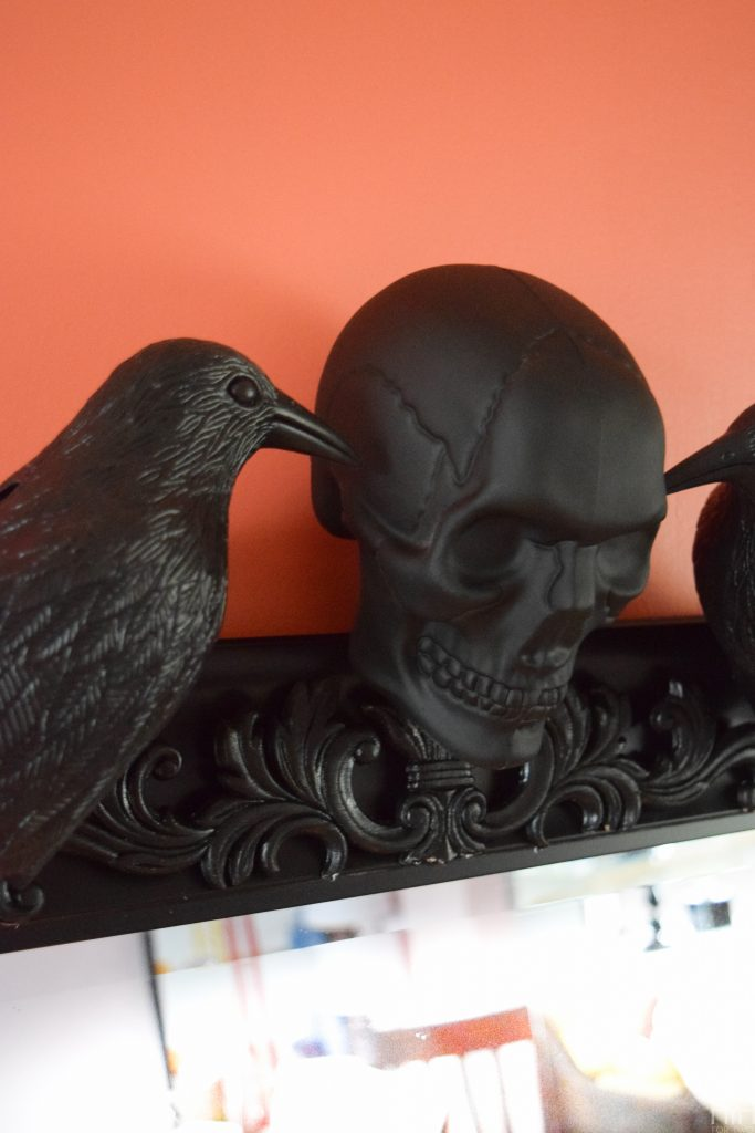 Create a show-stopping piece of Halloween Decor for your entryway using items from the dollar store and an existing mirror