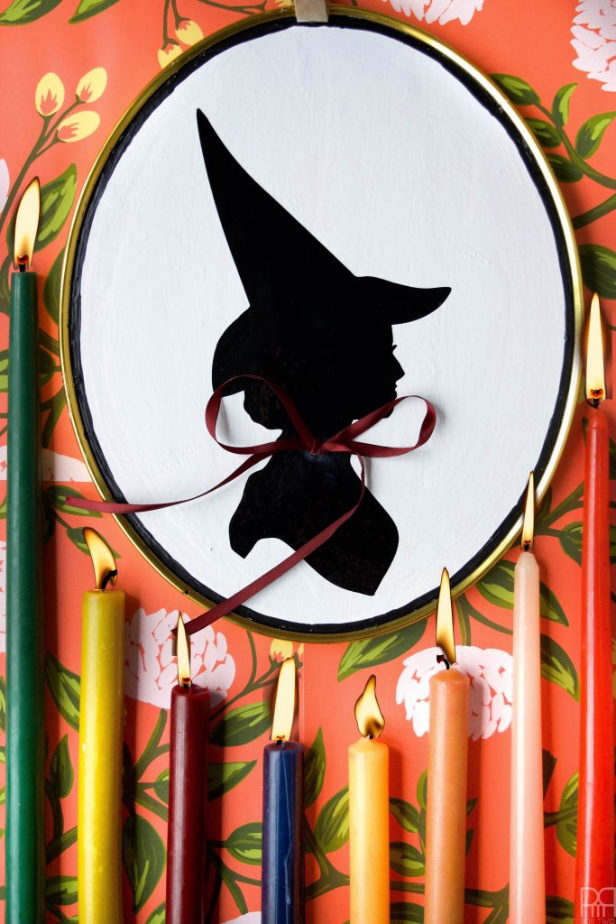 DIY Witch Silhouette Decor using your Cricut and thrifted frames. Halloween decor doesn't have to be cheesy to look good.