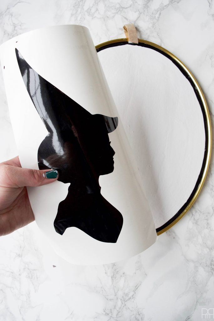 Make your own DIY Witch Silhouette Decor using your Cricut and thrifted frames.