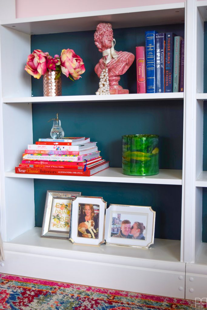 Using an IKEA bookshelf system and custom millwork we created rent-er friendly built-ins that can be moved when we move too!