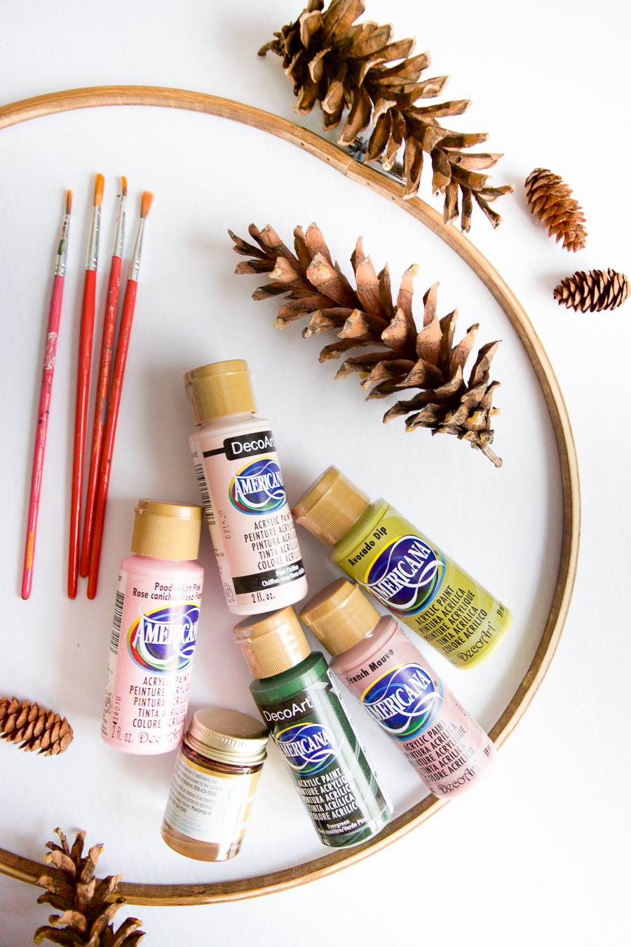 I painted pinecones in beautiful on-trend hues, and gluing them to a wreath - easy as 1-2-3!