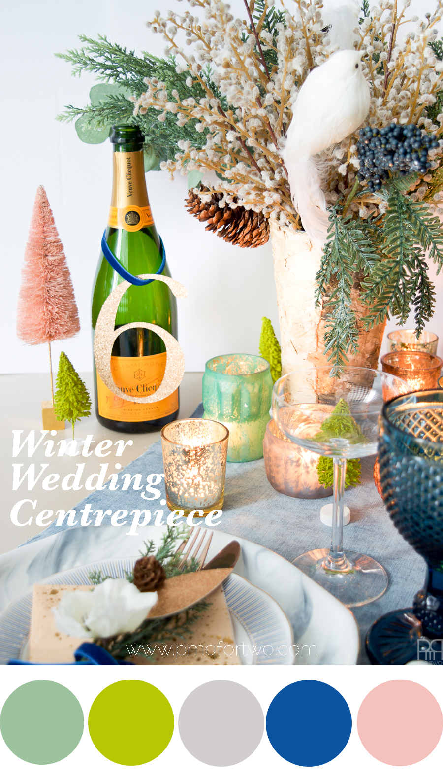 A Winter wedding Centrepiece full of greens, blues and a hint of pink! You can create a subtle winter wonderland using unexpected hues and lots of stunning faux florals. It's easier than you think!