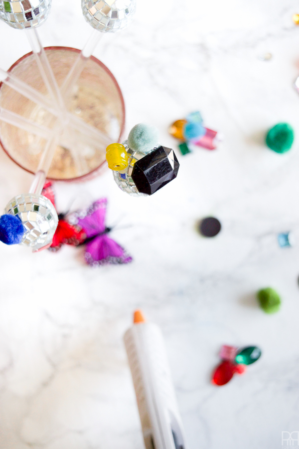 Using bits and bobs from around the house, I created colourful and eclectic disco ball drink stirrers inspired by legendary fashion icon Iris Apfel