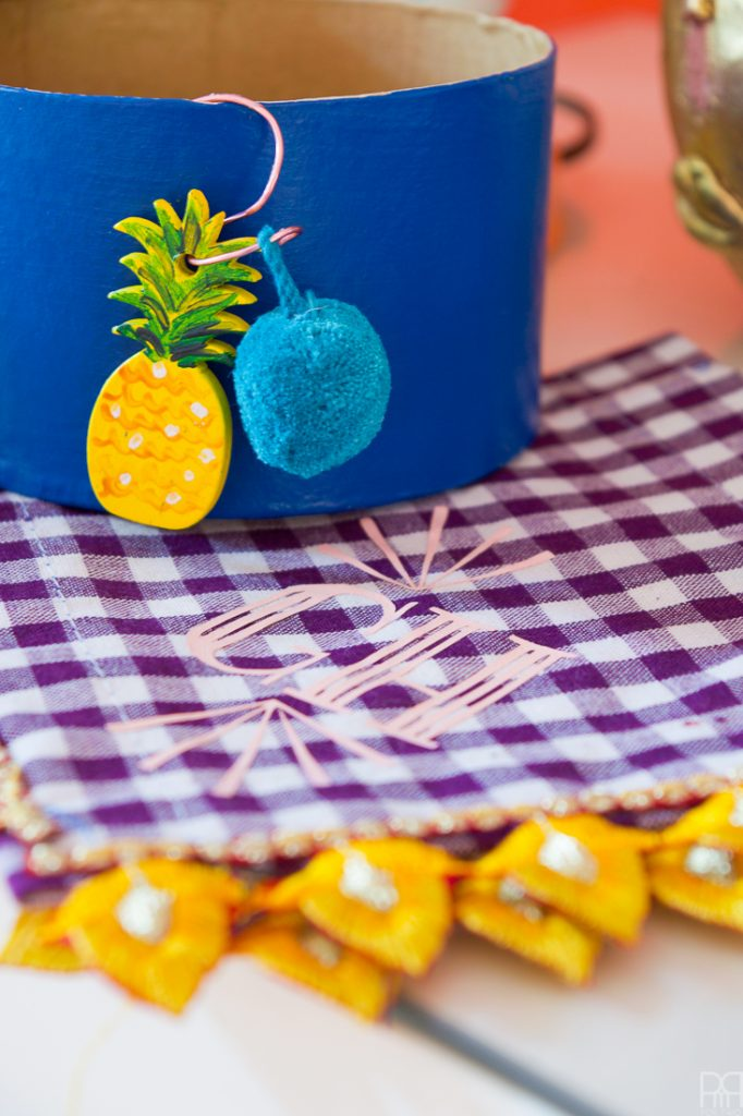 Make your own pineapple wine glass charms using acrylic paint and cute pom-poms. These cuties will look good with any glass of wine, rose, or other!