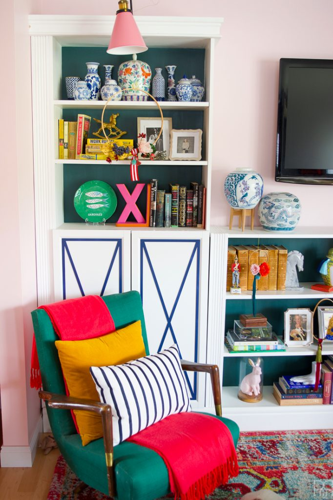 green chair in colourful living room
