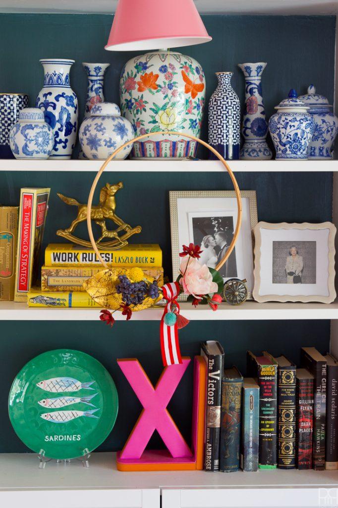 big hoop wreath in front of shelves