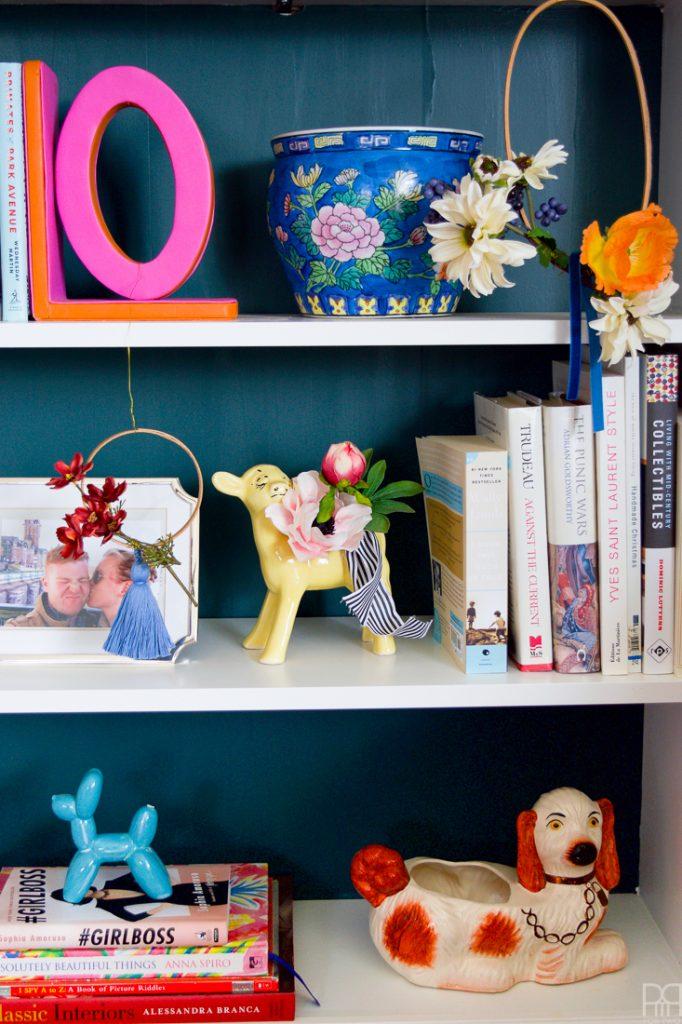 fall decor on bookshelves