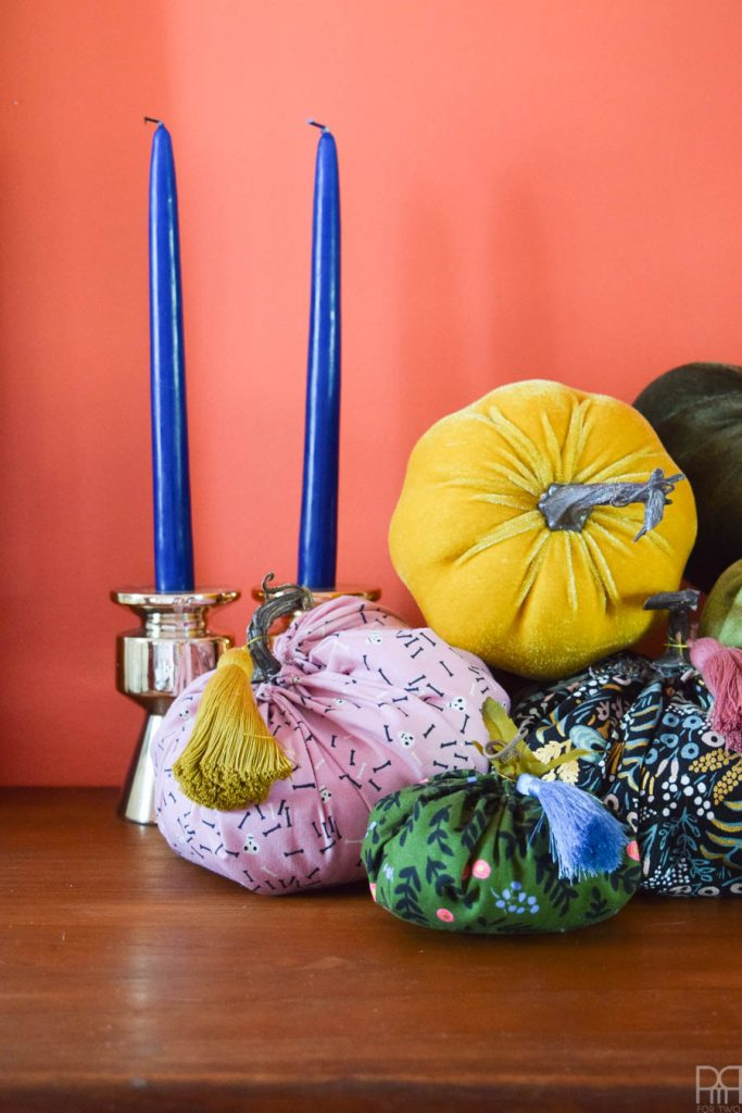 colourful fabric pumpkins on a sideboard