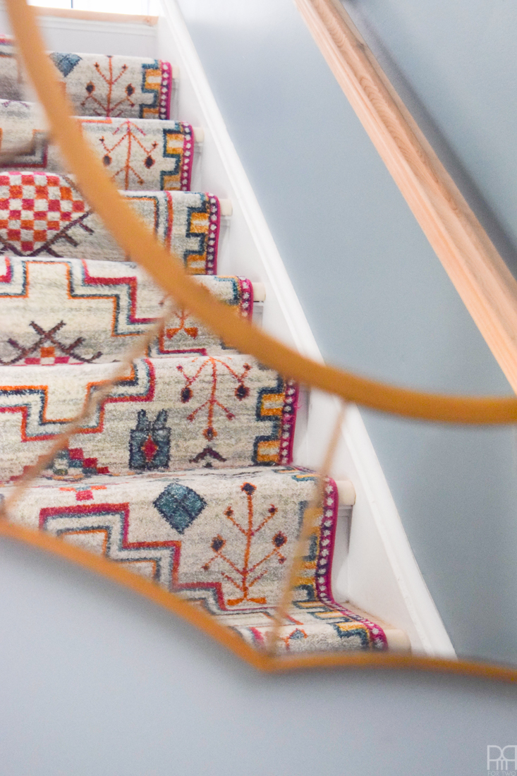 Using runners from Rugs USA I gave our staircase a makeover in a renter friendly way. Our staircase now looks like the main artery in our colourful and bold home instead of a space to hide. Head to the blog to see what products I used and why it's renter friendly.