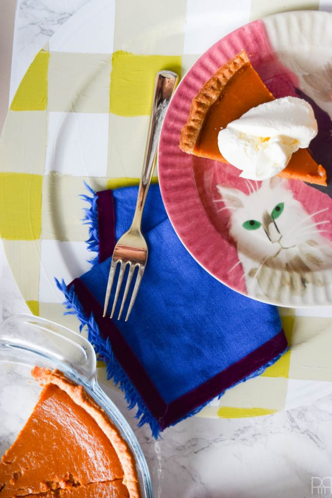 Using Americana's chalky finish paint you can cover-upugly plastic plates and create beautiful painted plaid chargers.