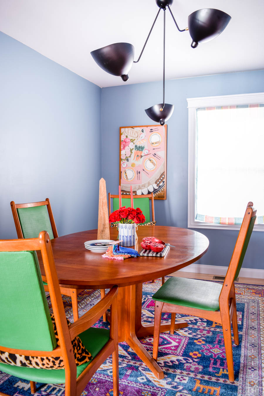 A fresh coat of paint, some cute and colourful art, well placed accessories, and of course - kick-ass furniture. That's how this ORC came together. My MCM dining room table and sideboard never looked so good!