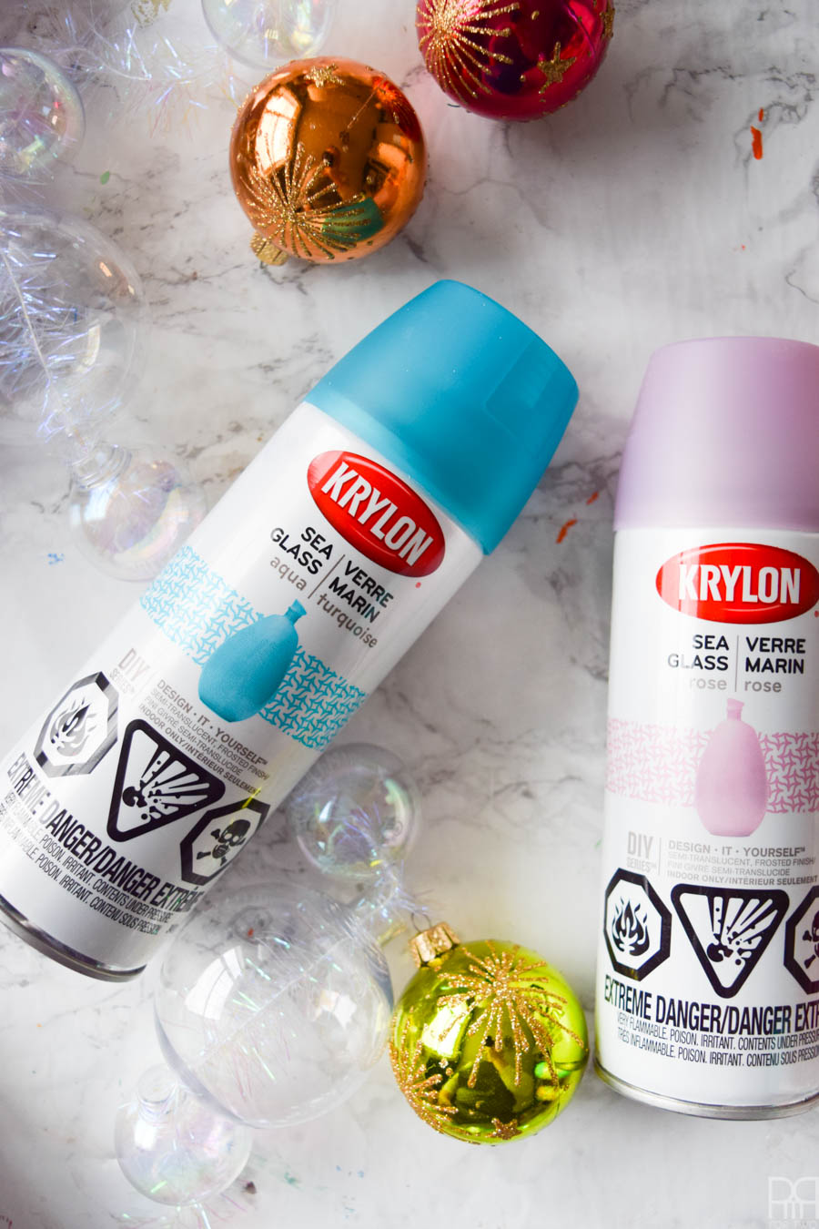 Spend an afternoon creating the perfect Christmas garland using old ornaments and some Krylon spray paint for a beautifully dusted look. Unicorns do exist y'all, and this garland is proof. #krylon #spraypaint