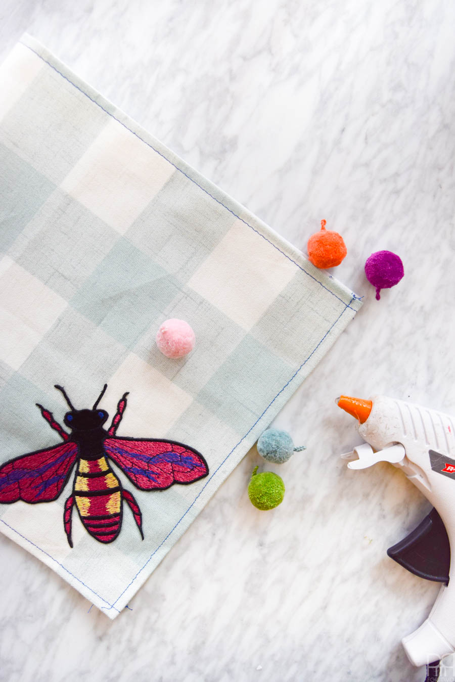 Inspired by the hit runway fashion trend, these DIY Gucci Inspired Tea Towels are easier to make than you'd think! Grab some fun fabric prints and these affordable iron-on patches, and you're ready to go!