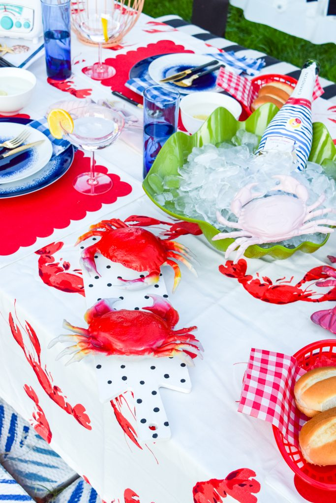 colourful seafood tablescape with champagne and lobsters