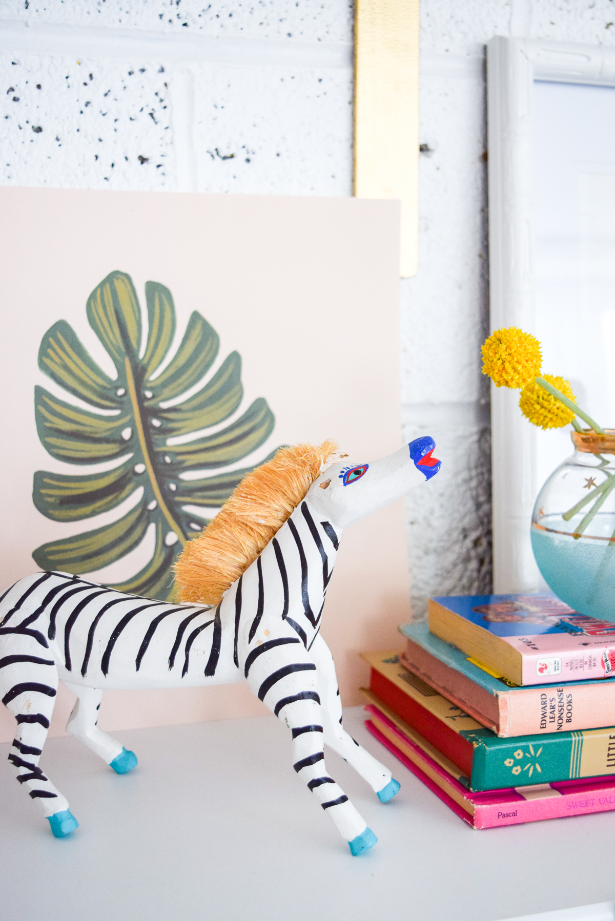 handmade wooden zebra on a shelf