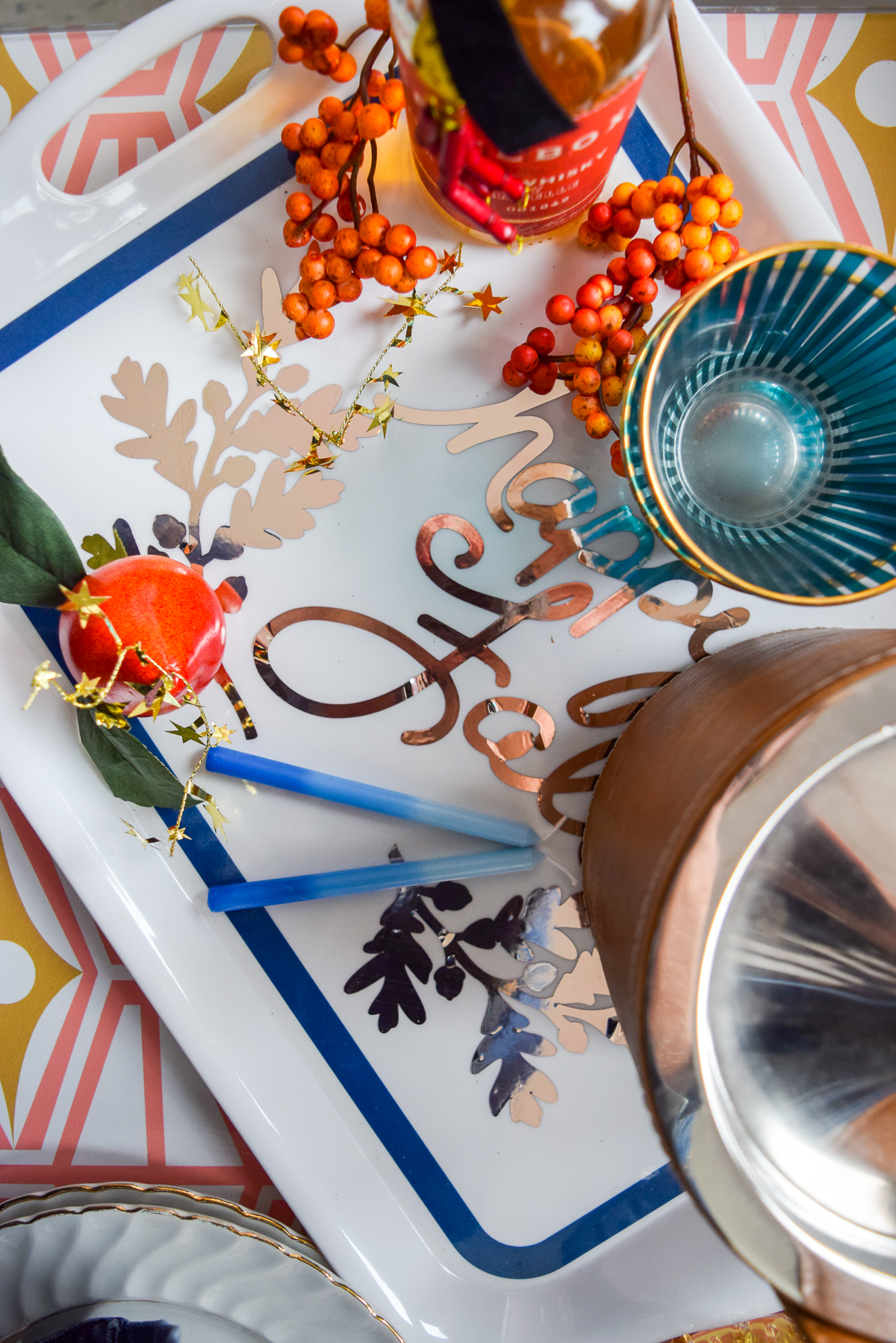 overtop shot of a tray with fall berries and colourful cups