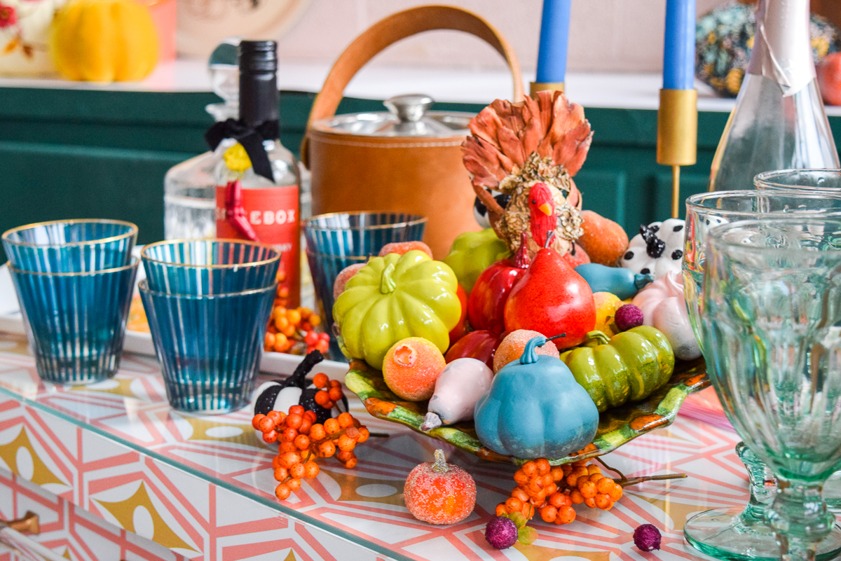 side table with a cornucopia and glasses
