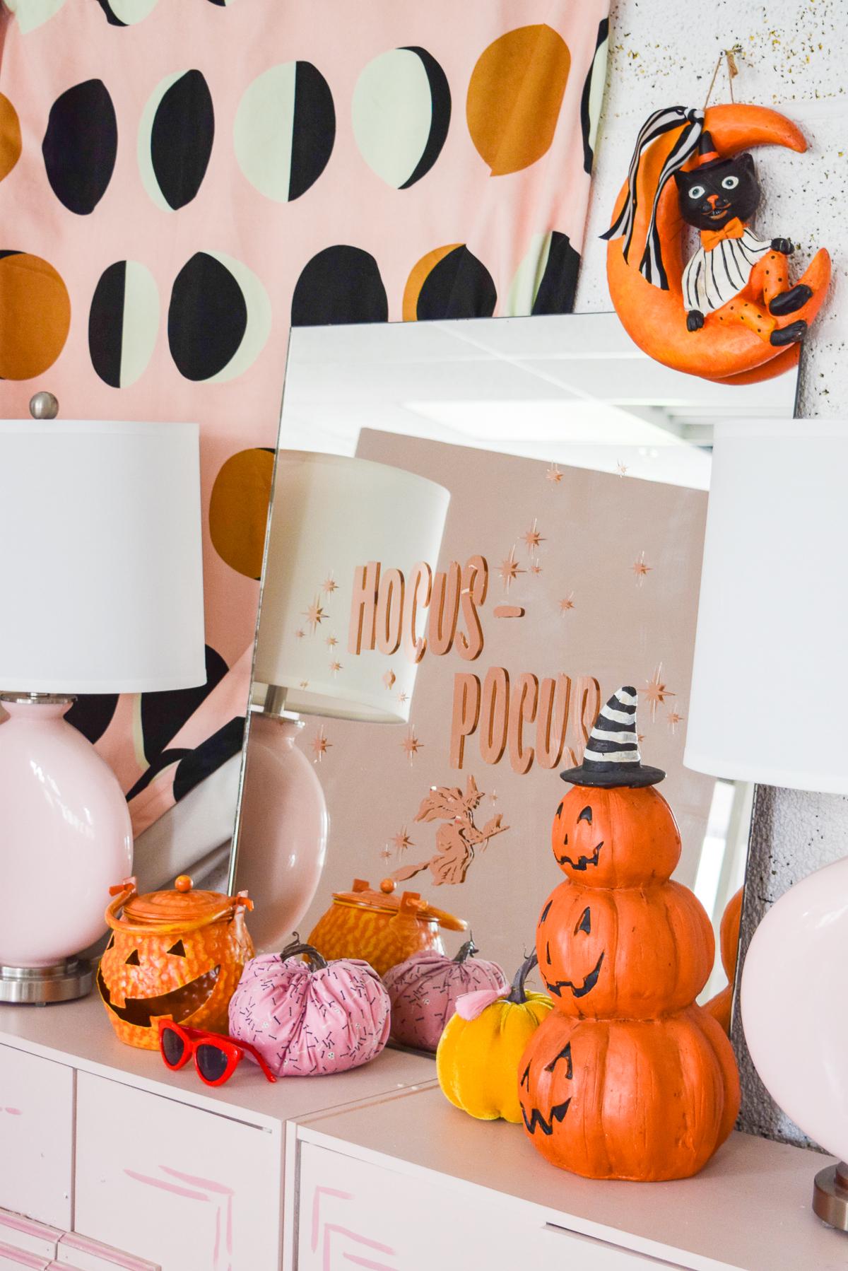 hocus pocus mirror on a pink sideboard
