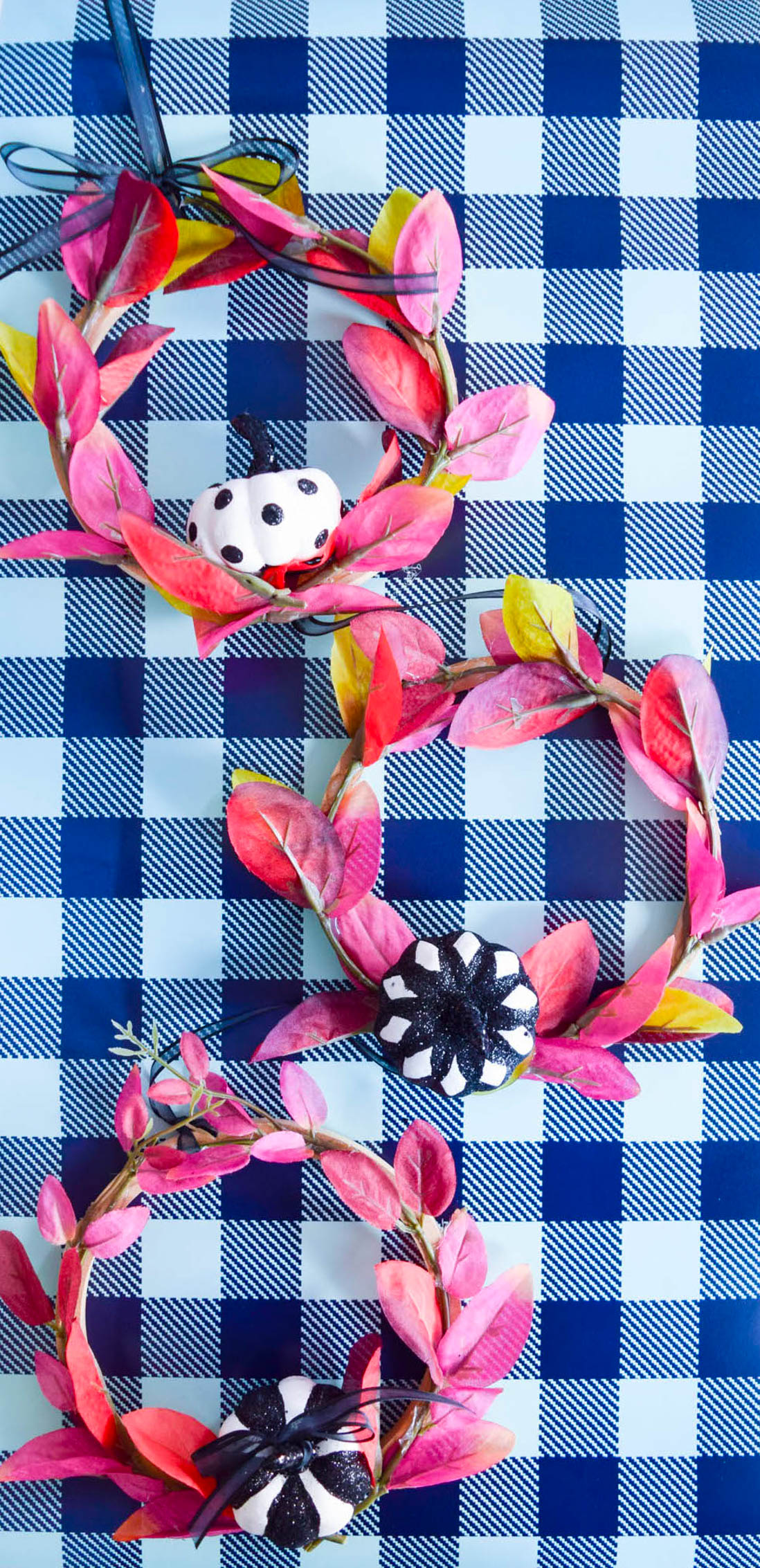 mini purple wreaths on a buffalo plaid blue backdrop