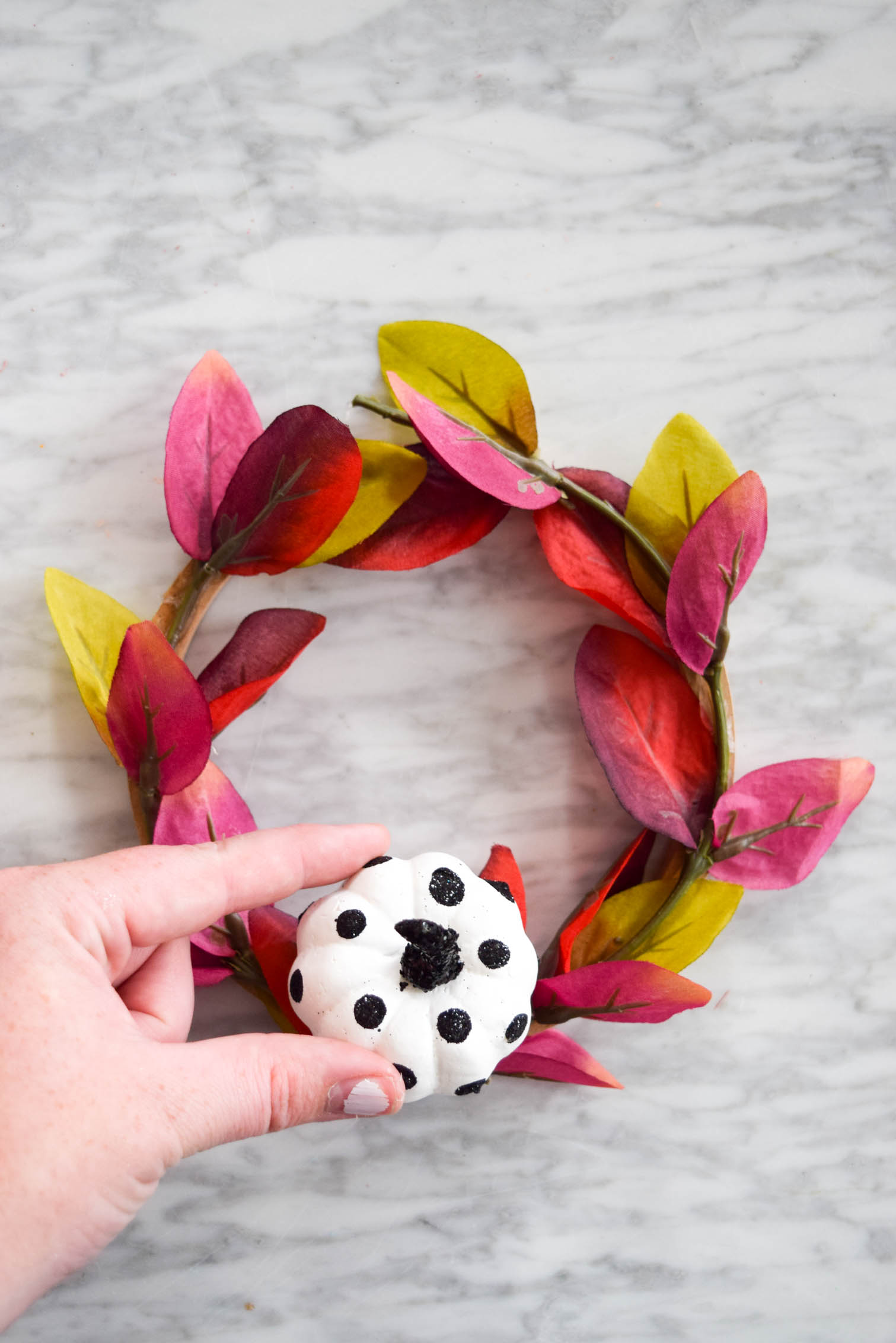 purple foliage mini wreath with mini polka dot pumpkin