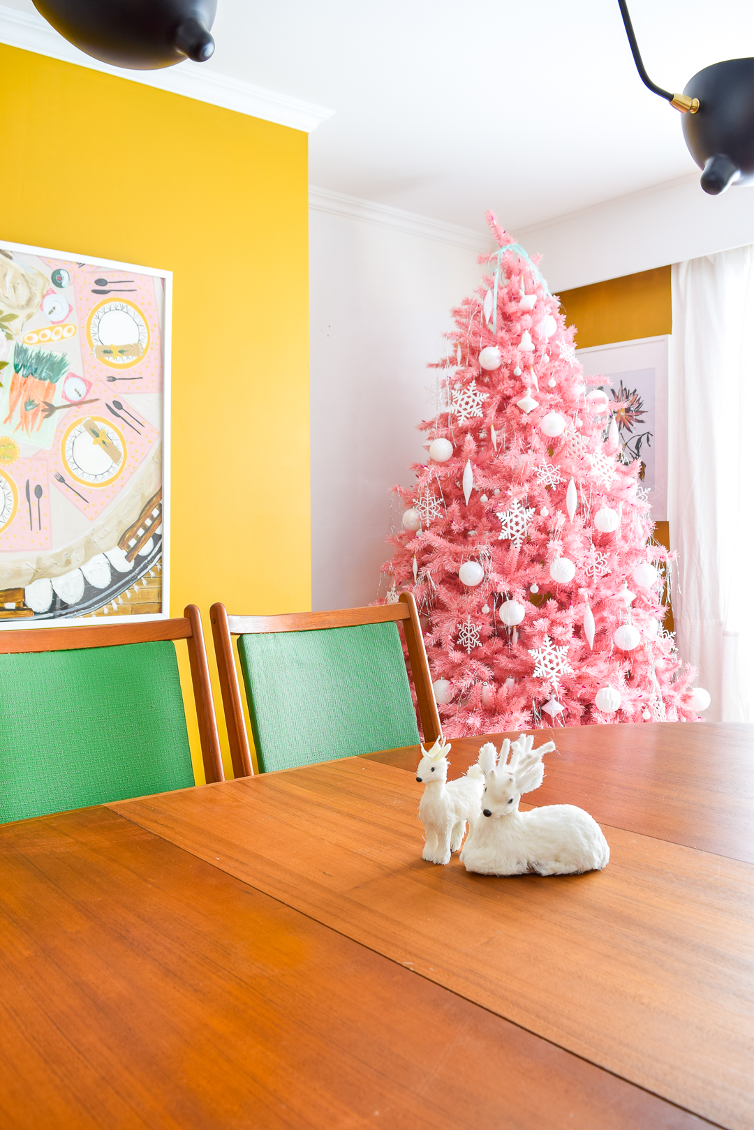 Come for a retro inspired Christmas home tour and check out our dining room, living room, entryway, and home office! Through sheer force of colour, pattern and decor, I am determined to make this pace feel like home for the holidays.