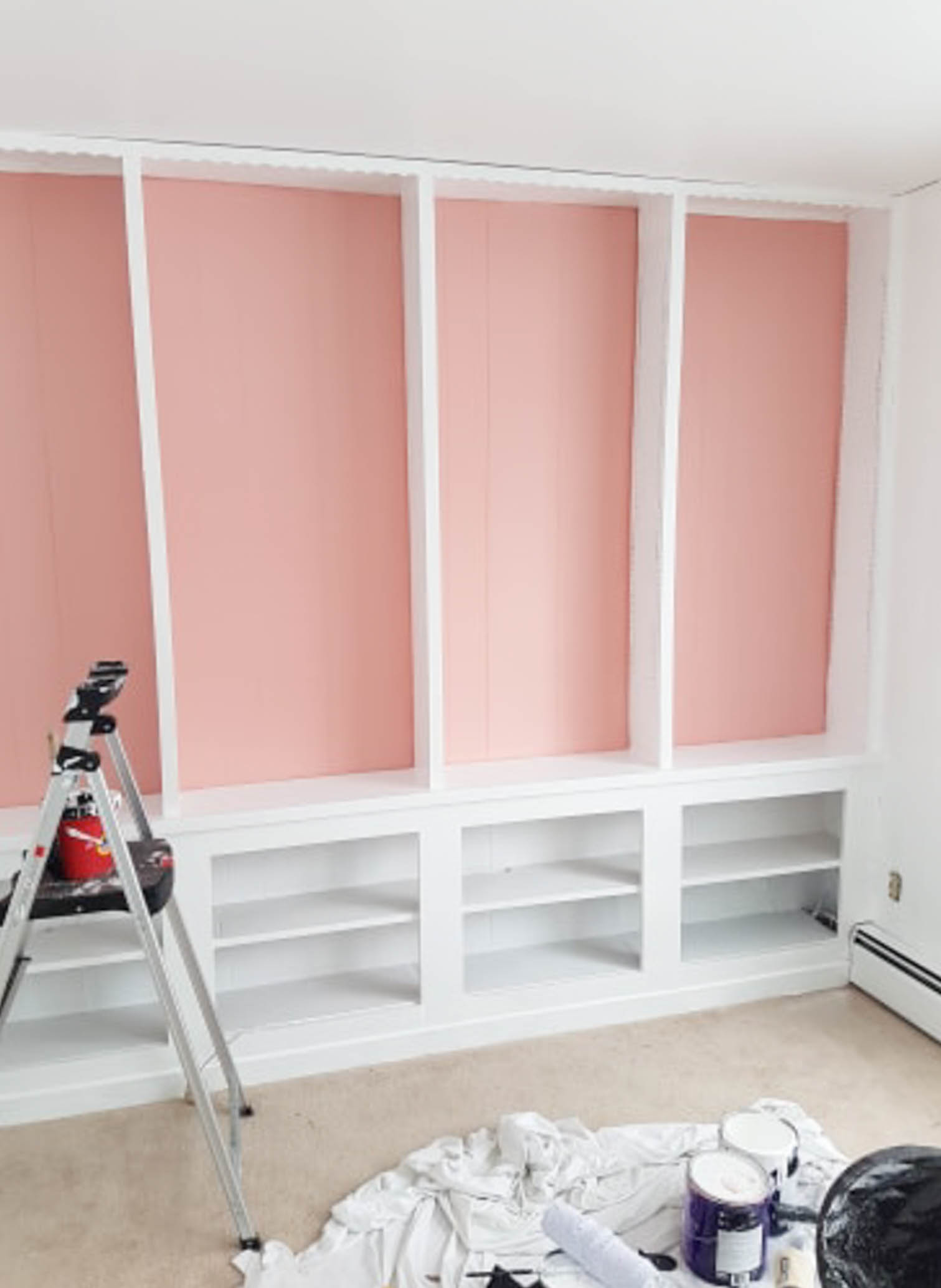We painted our wood panelling in a bright white and Noble Blush (pink) from BEHR paint, to create a feminine and colourful home office space.