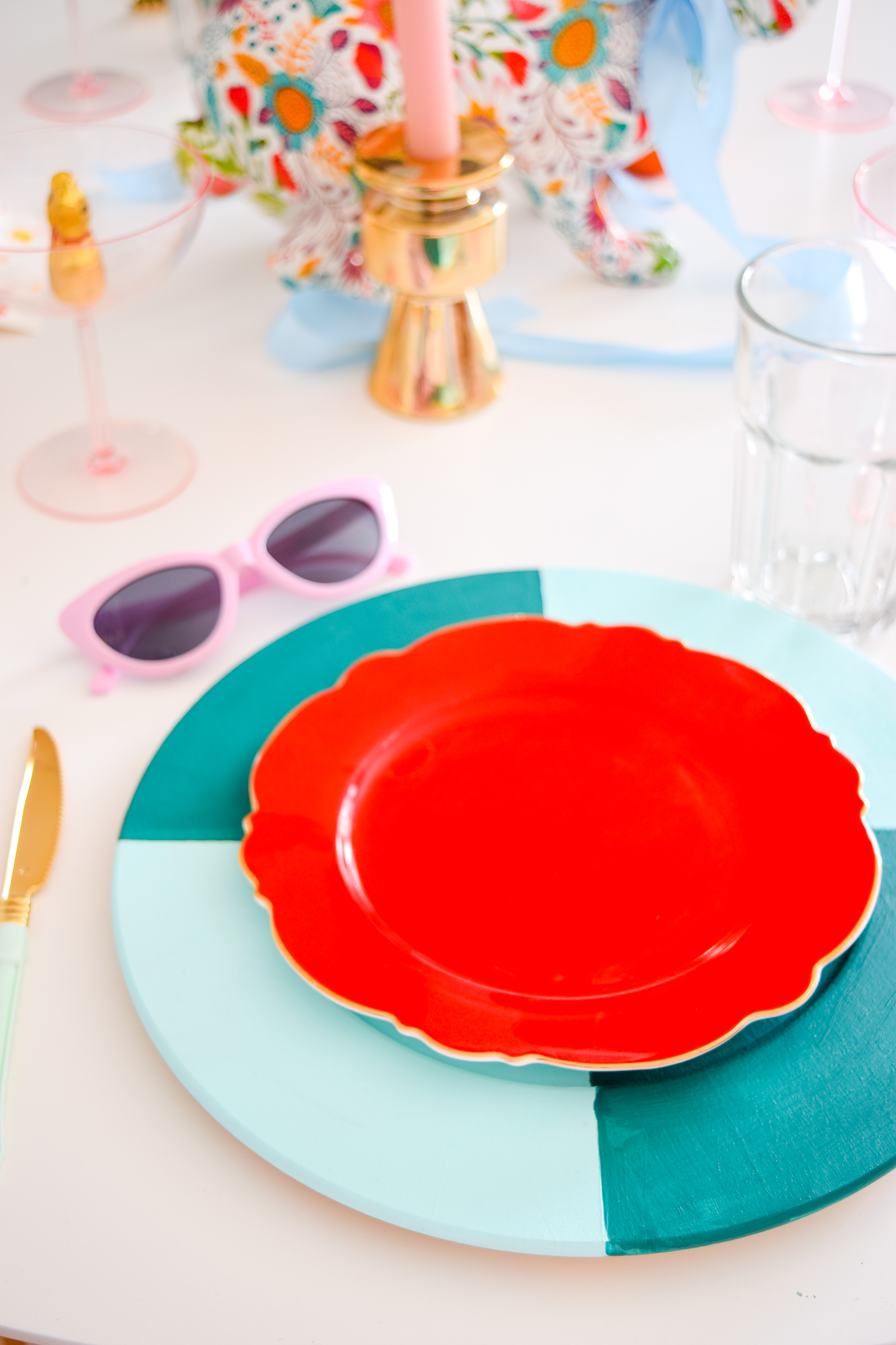 A bold & colourful easter tablescape is exactly what you need to kick start spring (in case she isn't already in bloom), and display all your chocolate too! I painted basswood chargers from Walnut Hollow with a bold colour blocked pattern, and love the result.