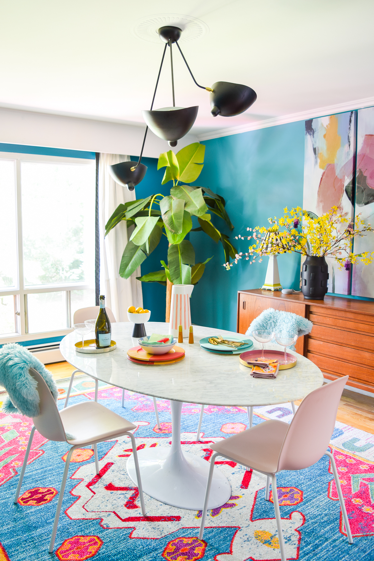 A mid century modern dining room, full of color, teak, marble, and color blocked walls. What's not to love? Come grab inspo and sources on the blog.