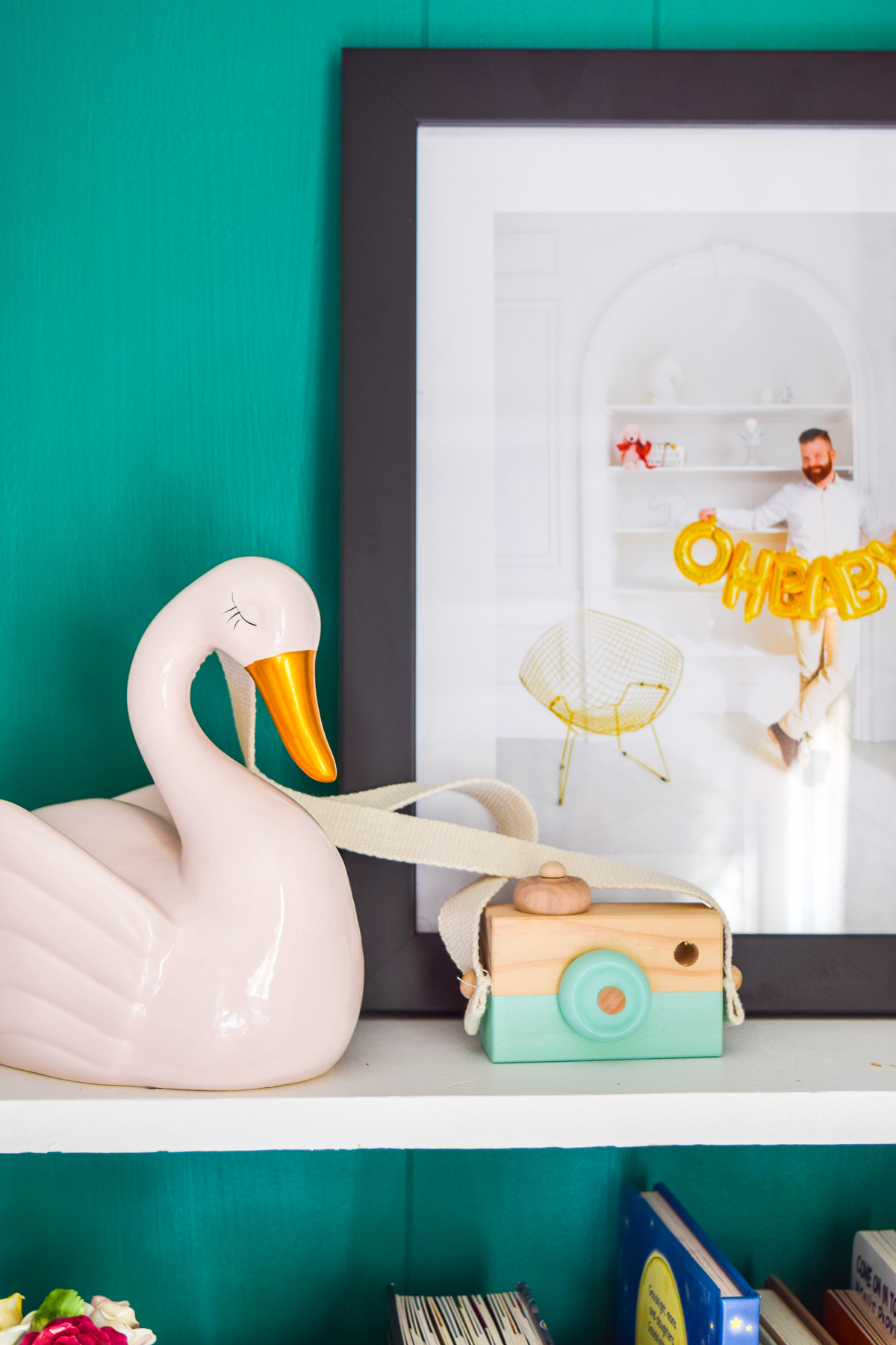 Nursery photo decor ideas don't have to be complicated. Frame a few well chosen photos to mix in with the rest of your decor to create a personal space. Mixbook offers easy to use online printing & framing services, come see how I used them in our Nursery.
