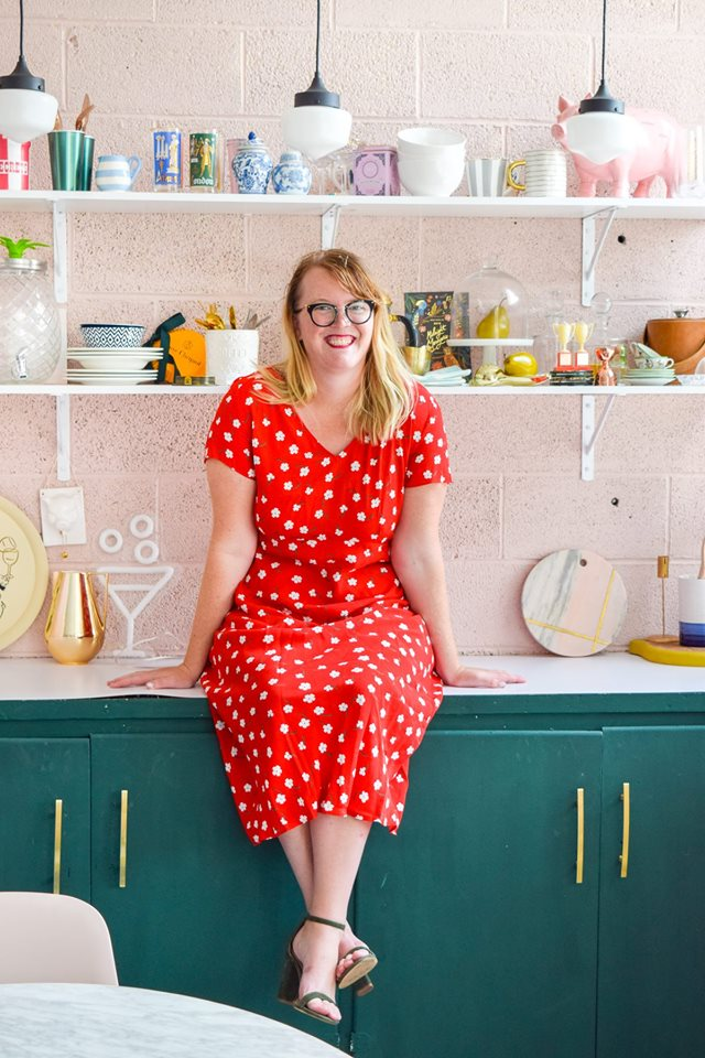 woman in red dress on counter