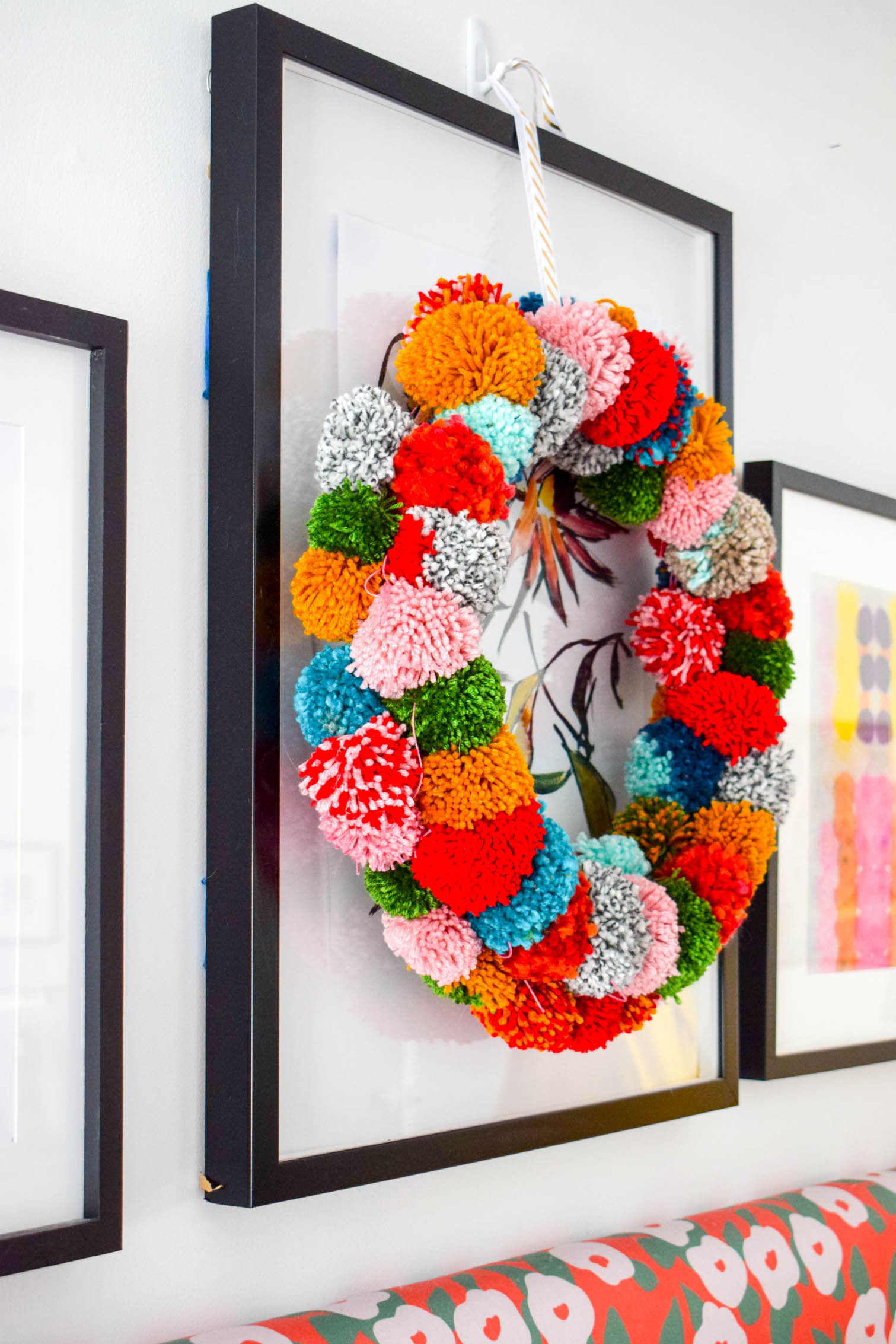 Make your own pom pom wreath this holiday season, and add a bold statement to your decor. This wreath is easy to make and a lot of fun to put together.
