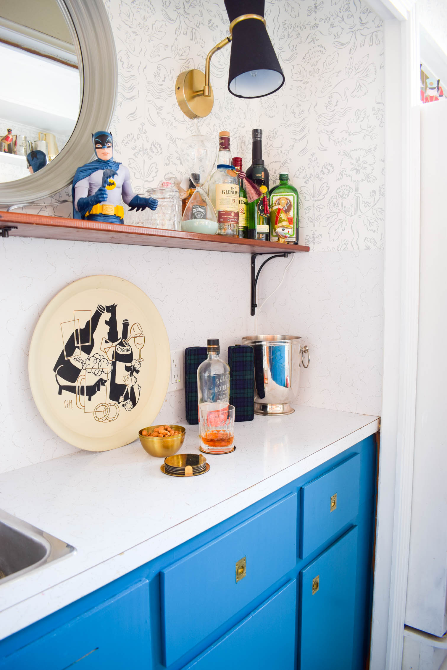 Our basement bar was a nightmare from the 70s, and now it's a clean modern space. With a few budget friendly updates we took it from drab to fab. Freshly painted cabinets, peel and stick floor tiles, and new wallpaper are just what the space needed!
