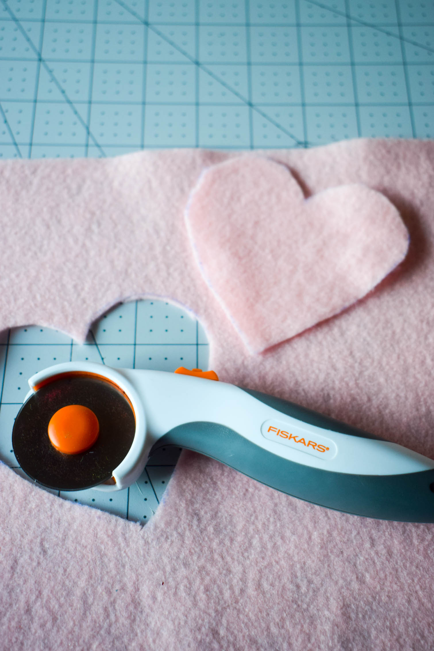 DIY Heart elbow patches are the easiest way to refashion a sweater. Using felt and a needle + thread, you can add adorable style in a few minutes to any top