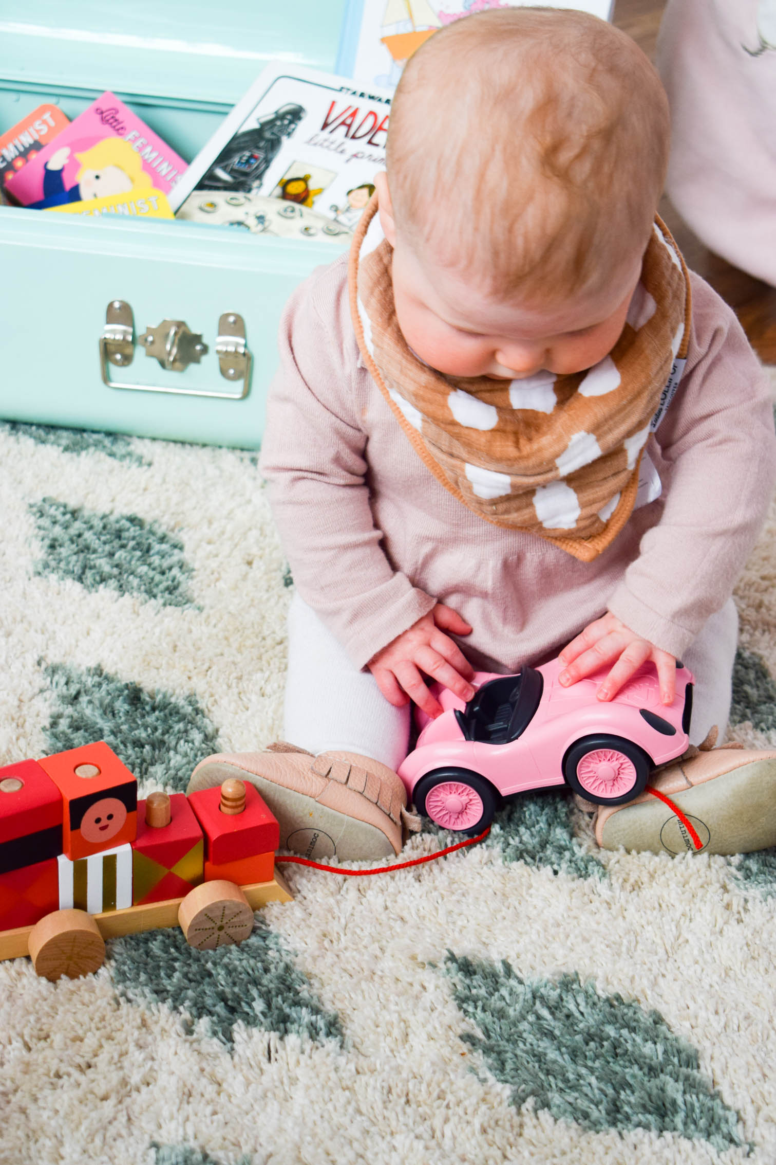 Creating stimulating and enriching activities for a baby can't be tricky, so I've created a toy box full of colourful baby play time ideas.