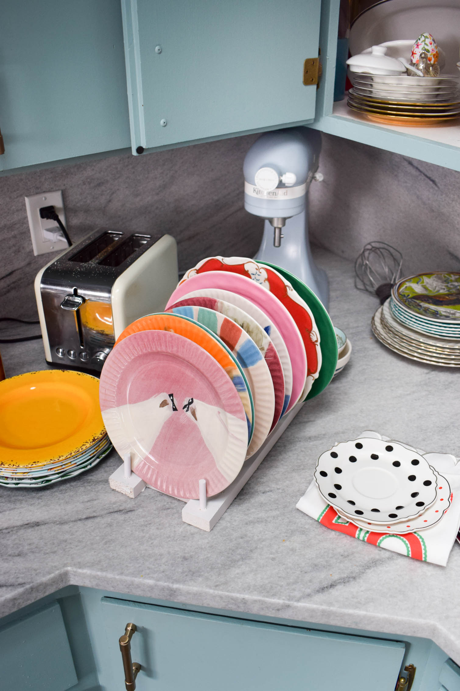 Make some DIY plate racks to organize all your kitchen dishes! You can make yours in a day using wood scraps