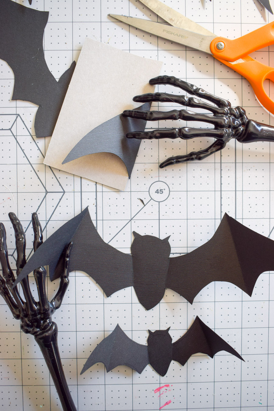 Make your own easy DIY Paper Bats using cardstock and some sharp scissors! It's that easy, and you can customize them too