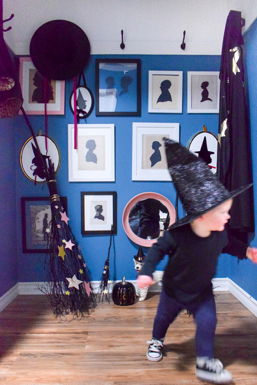 Turn your entryway into a spooky and glam witch broom closet. One that any witch would be pleased to hang her cloak in.